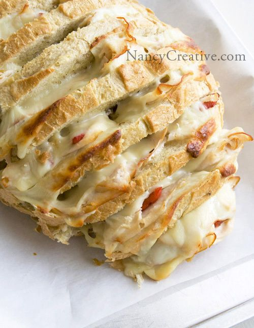 Cheesy Stuffed Sourdough Loaf [made with loaf you purchase] via Nancy Creative #nibbles