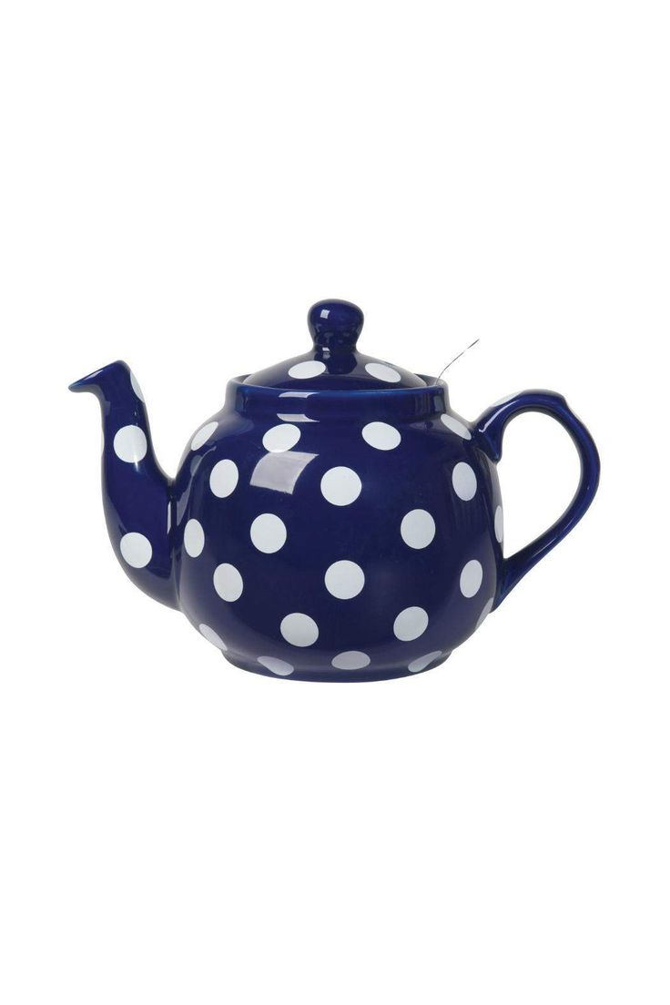 Farmhouse teapot in glazed stoneware has a traditional silhouette, with modern conveniences such as the built-in mesh filter and dripless spout. Teapot is cobalt in color with white spots.    Capacity: 36 oz / 4 cups   Cobalt Farmhouse Teapot by Now Designs. Home & Gifts - Home Decor - Dining Minnesota