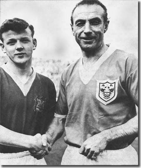 The youthful Billy Bremner shakes hands with the great Stanley Matthews before the Leeds-Blackpool game on March 5 - Leeds lost 4-2