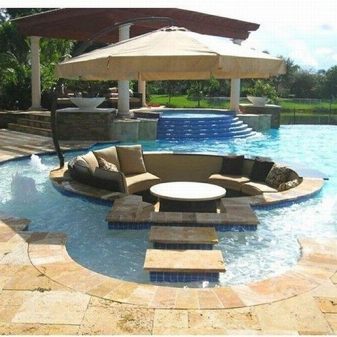 I love this - a sunken conversation pit in the pool.  It could be worked in with the other features of the pool, and be a really fun spot to relax in.