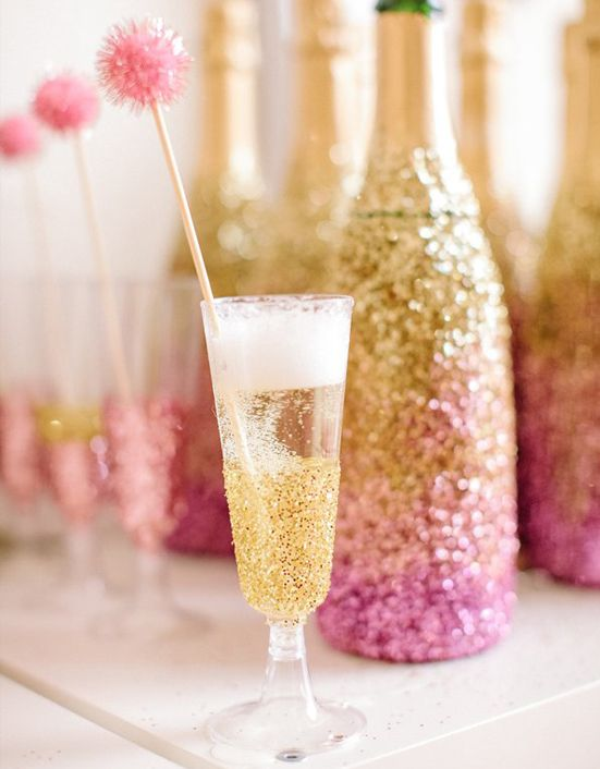 use modge podge or wrap a champagne glass with double-sided tape and roll it around in glitter {add a sparkly pom pom for fun}