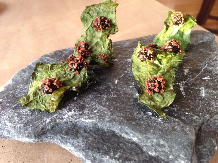 Amuse-bouche #3: Stair step-shaped Crispy Kale with Black Truffle served on a stone slab