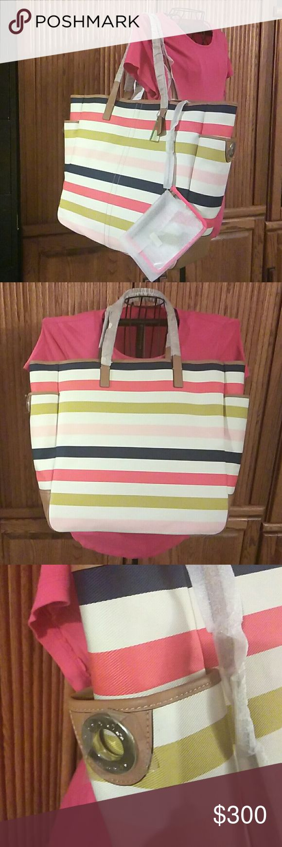 AUTHENTIC COACH MULTI STRIPE TOTE THIS MULTICOLORED STRIPE TOTE BAG HAS 2 DEEP POCKETS ON THE LEFT & RIGHT SIDE OF THE BAG! BOTH POCKETS ALSO HAS SILVER HARDWARE  ON EACH POCKET WITH ORIGINAL HANG TAGS! THIS IS A VERY SPACIOUS BAG WITH ONE ZIPPERED POCKET! TOP OF BAG HAS A DOG LEASH CLOSURE...NWT Coach Bags Totes