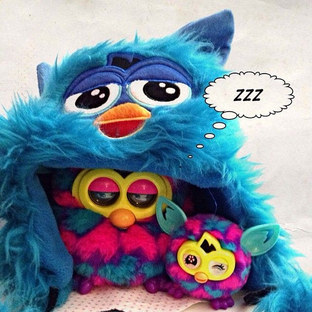 A furby boom mother with his Furbling on a, what's that ...