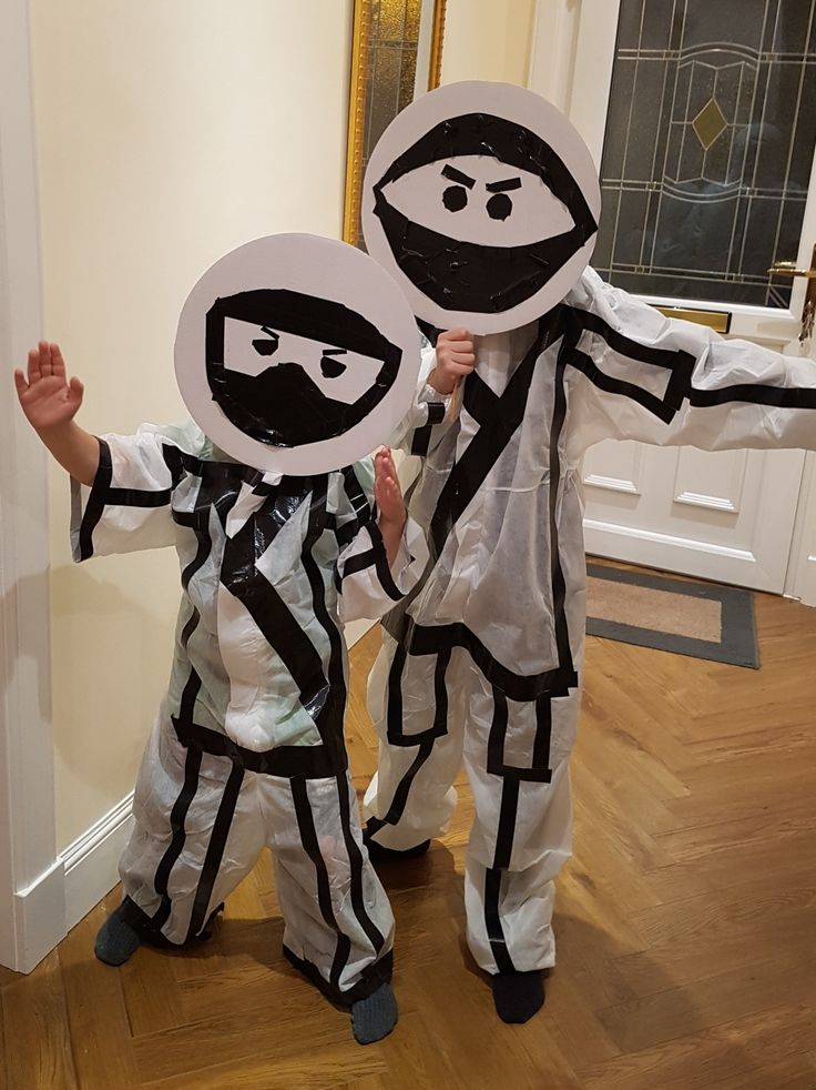 Stick man ninjas made with duct tape and painter overalls