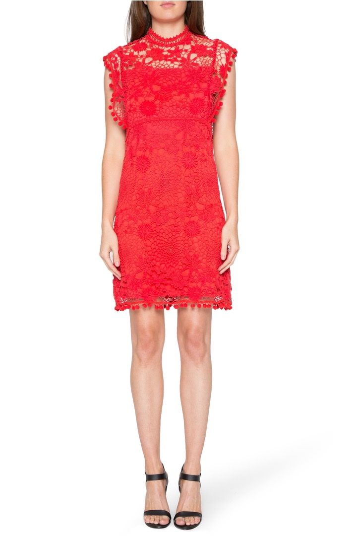 This bold, high-neck lace shift dress makes a statement at any occasion.