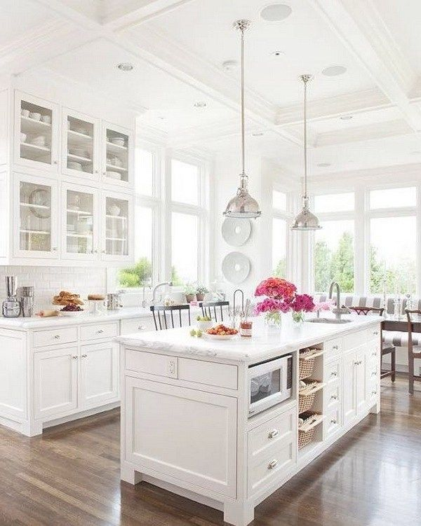 All-white kitchen with white tiles, white cabinets, marble counters, and tall ceilings, this kitchen looks calm, cool, and collected.More via http://forcreativejuice.com/elegant-white-kitchen-interior-designs/