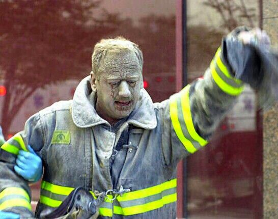 This is what a HERO looks like. Tears streak down this firefighter's ash-covered…
