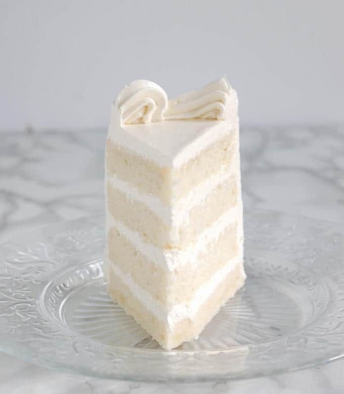 Have you ever taken a bite of a beautiful white layer cake only to be disappointed by it's rubbery texture and bland taste? With the proper ingredients and mixing technique, White Cake can be soft and velvety with a perfect vanilla flavor. Yes, even from scratch in your very own kitchen it is possible to...