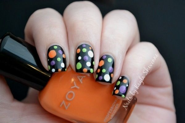 Halloween is coming up, which means lots of candy and searching for the best costume. So if you're looking for something to get you in the mood for some trick-or-treating, nail art is a great option. These cute and creepy designs will show off your ghostly flare. They're a great back-up costume or just adorable to show off. With these spooky nail art designs you can easily join in the Halloween Spirit. DIFFICULTY LEVEL: EASY Polka Dot