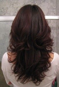 Long layers with lots of volume wish my hair would look good this long!