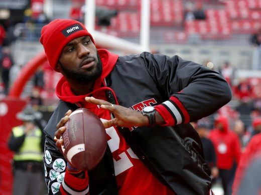Cleveland Cavaliers superstar LeBron James plays catch before Ohio State game against Michigan Nov. 26, 2016.