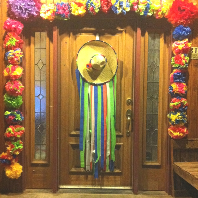 Fiesta themed decorations we did for my bf bridal shower. I made a bunch of the tissue paper flowers. Then we measured the door frame with twine. We used the pipe cleaners on flowers to attach to the string. Then we started tacking it to frame. About every 5 flowers we tacked.  For the sombrero I just hot glued streamers on the back.  Ole!!