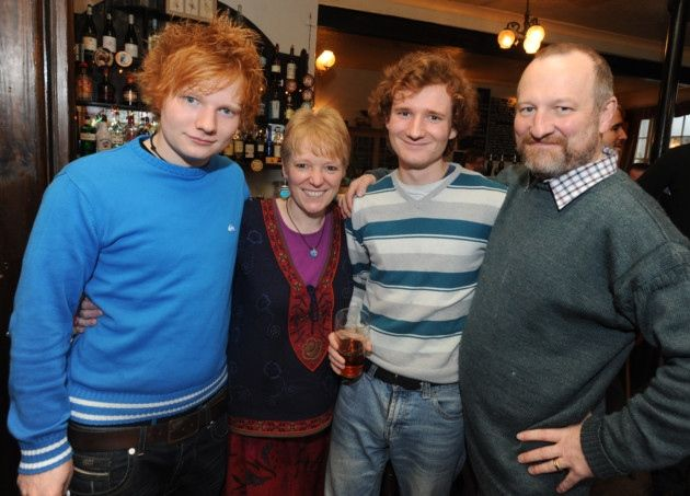 Singer Songwriter Ed Sheeran photographed in Framlingham's The Station Pub with his family. .l/r Ed Sheeran, mum Imogen, brother Matthew and dad John