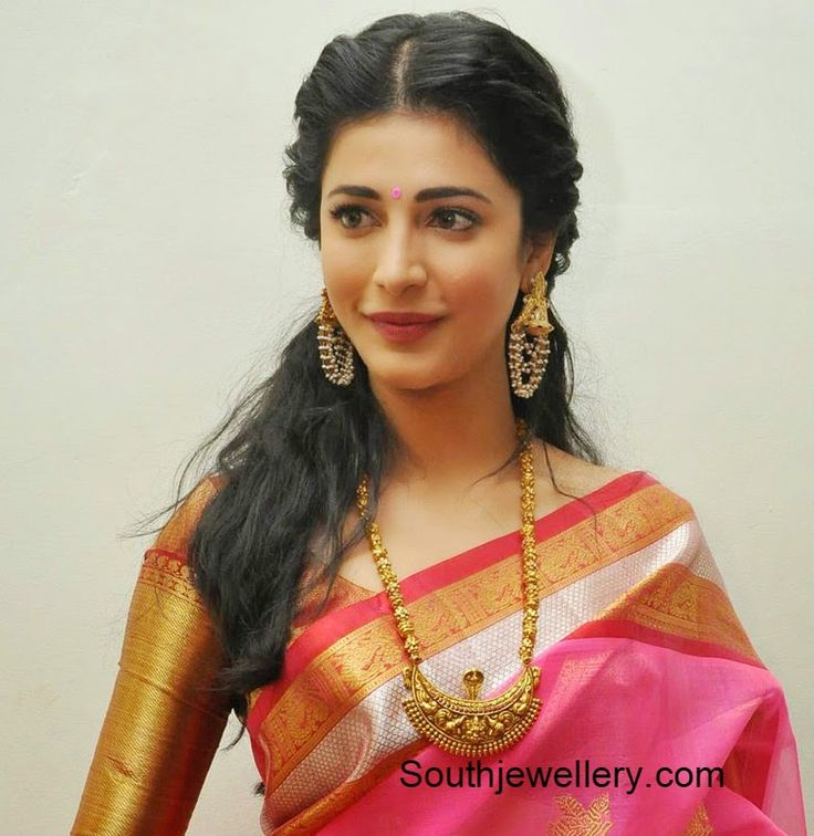 Shruti Hassan in a silk saree and blouse. Love the big earrings and necklace. Bollywood fashion.