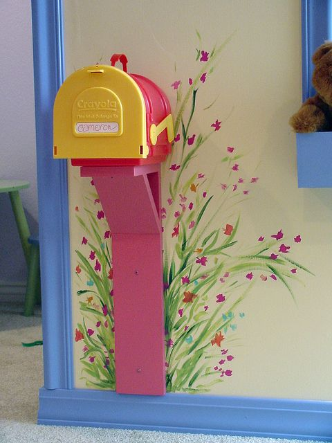 Just the (brightly colored) mailbox in weird entry door area? Or put a few outside with tools/toys in it? Like this.