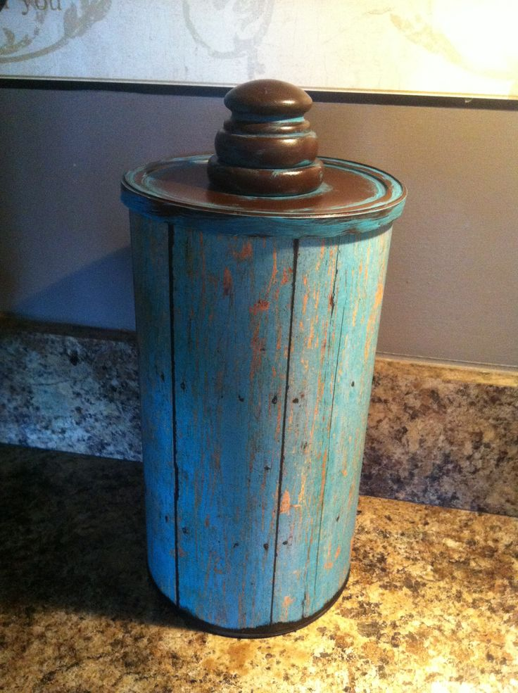Countertop Trash Can from an oatmeal container.  Steps:  •Cut rim off container •Cover with scrapbook paper and mod podge •Attach a knob to the lid •Spray paint lid •Seal scrapbook paper with polyurethane or clear spray paint  This only took thirty minutes from start to finish, minus the seal-coat dry time. :)