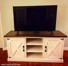 This large media console has a thick farmhouse top, rustic X accents and plenty of storage!
