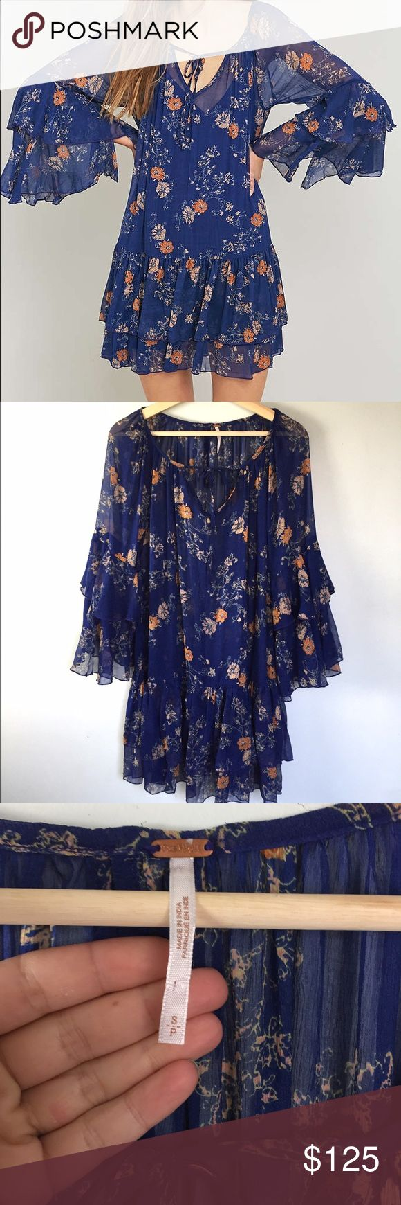 HPFree People SALE!!!!!Sunsetter dress Beautiful + Gorgeous Sunsetter floral dress by Free People in blue combo. No flaws. Size small. Tiered sleeves. Missing the slip but you can use your own. (This is reflected in price) dress is in mint condition with no stains, holes or rips. Cleaning closet and it's got to go. Free People Dresses Mini