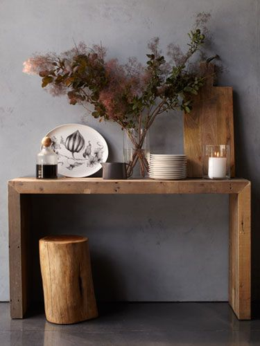 Unadorned wood pieces that boast a natural beauty and elegance are sneaking into chic houses.