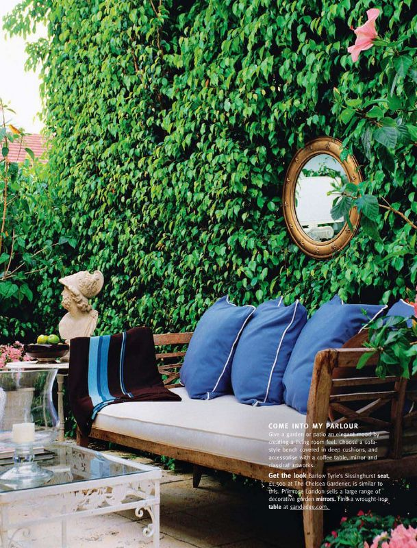 mirror in ivy. Ivy wall is a nice backdrop to the outdoor seating area.