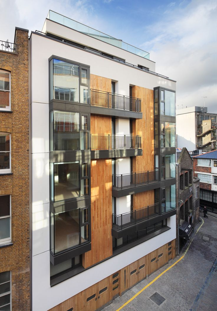 Built by Emrys Architects in London, United Kingdom with date 2011. Images by Alan Williams. Emrys Architects creates tranquil contemporary apartment building off Oxford Street in London's West End.      	A rec...