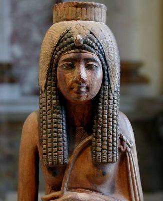 Wooden statue of Queen Ahmose-Nefertari, excavated at Deir el-Medina, Dynasty XVIII; 43 cm; Fondzione Museo Antichita Egizie, Turin, Italy.