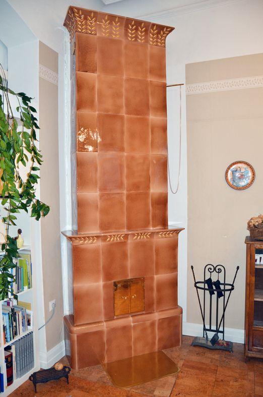 3,2 m high tile stove.