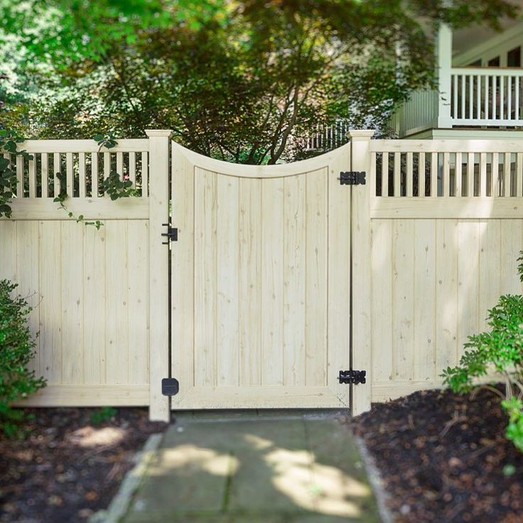 Awesome backyard fence idea. Curved PVC vinyl gates from @illusionsfence come in all 35 colors and 5 wood grains of the Grand Illusions series. #illusionsfence