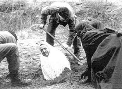 """Preparing to stone a woman to death. Soraya Manutchehri (stoned in 1986 for being an """"inconvenient wife"""" and whose life inspired """"The Stoning of Soraya M."""" drawing much attention to the suffering and murder of many more women under Sharia law)"""