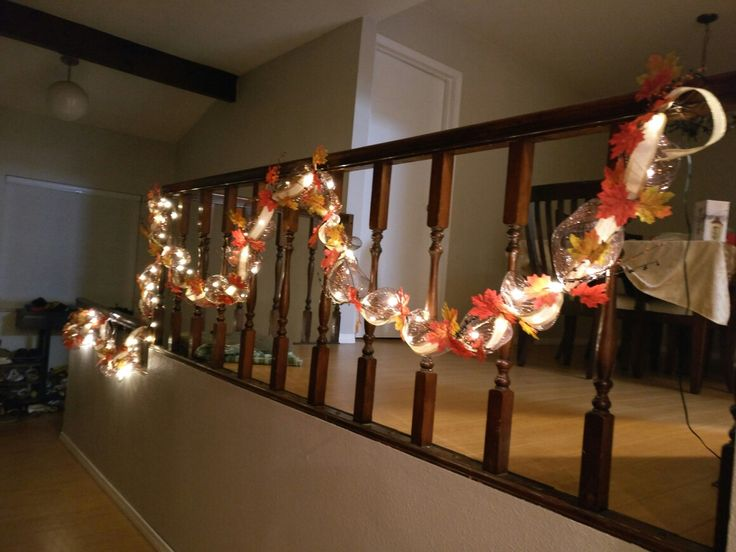Easy autumn deco mesh garland with led string lights. Used naturally wrapped wire to wrap the deco mesh around and small pieces of the wire to pinch the deco mesh, ribbon, and lights. Then stuck pip berry sticks in and glued leaves on to the small pieces of wire