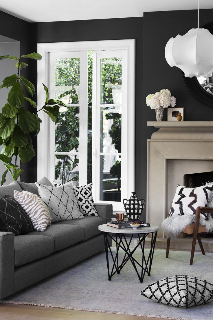Inspiration for a mid sized timeless enclosed living room remodel in - Gray Couch With Dark Walls Living Room Inspiration
