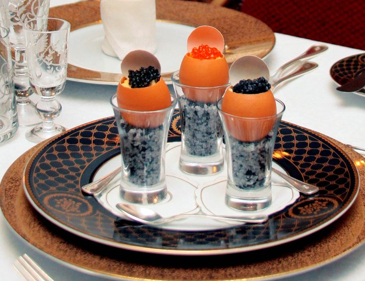 """""""Egg in egg"""" dish at the Caviar Bar and Restaurant! Ultimate caviar delight – three eggs filled with truffle flavored scrambled egg topped with beluga, oscietra and salmon caviar!"""