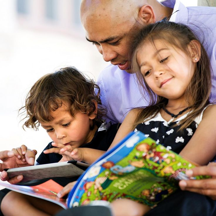 Image result for mom and dad reading a story together