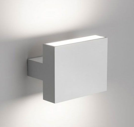 Tight LED Wall Light by Flos Lighting | F0011009 @Dwight McNeill  Interesting idea for great room sconce. It goes up and down. Yay? Nay?
