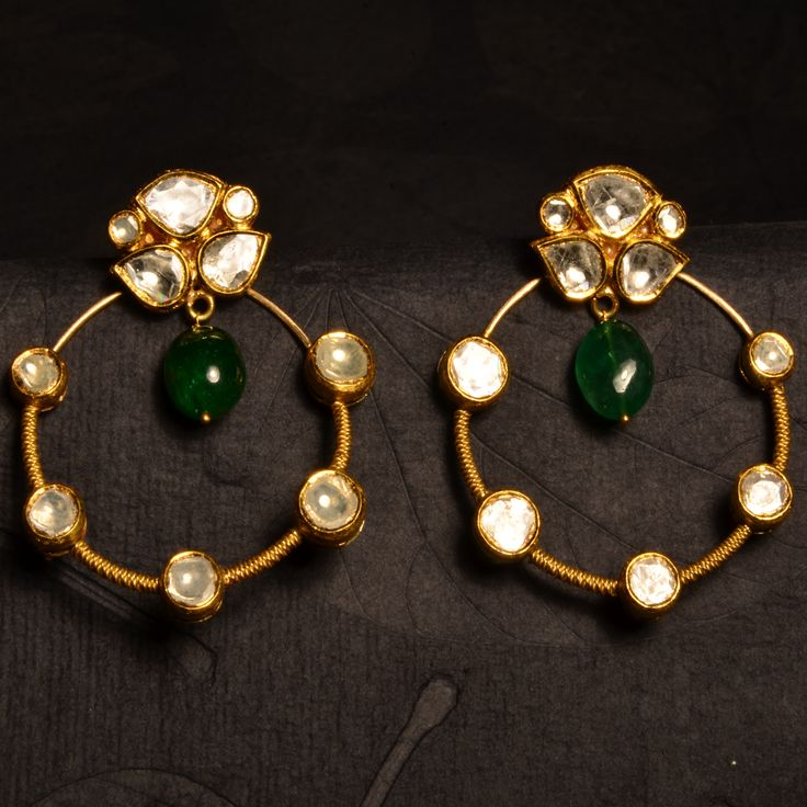 Young Kundan - Versatile pair of kundan earrings in 22k gold, incorporating uncut diamonds and emeralds, may be worn with or without the hoops to suit the occasion.