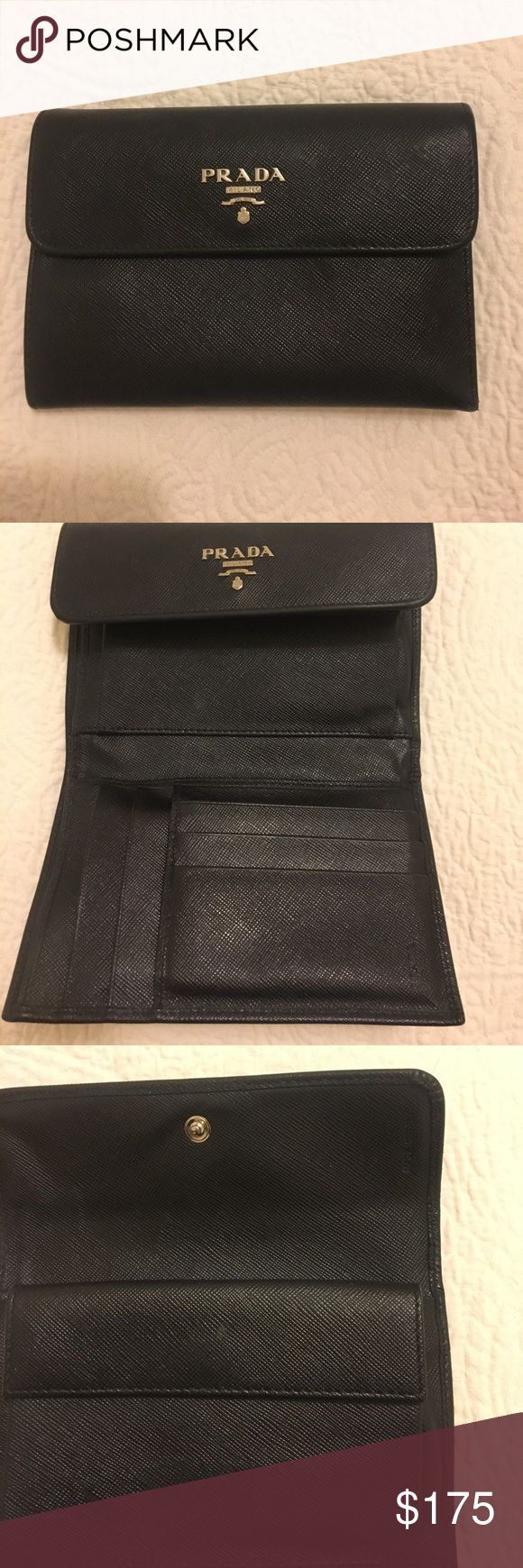 Prada black Saffiano Leather Wallet Prada black Saffiano Leather Wallet. In great condition!!!!! Shoes in picture to show size of wallet. Only 2 hours left at this price Prada Bags Wallets