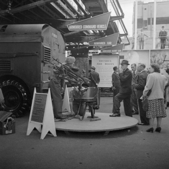 Men and women examine an exhibit entitled 'To beat the dive bomber' at the large-scale Army exhibition held on the bombed site of the John Lewis department store on London's Oxford Street, 1943. - See more at: http://ww2today.com/15th-august-1943-time-to-relax-as-bombers-are-heard-overhead#sthash.581jMSOp.dpuf