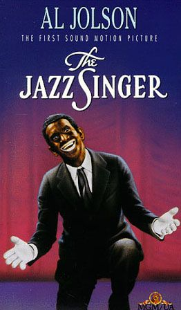 """Warner Bros. premiers, """"The Jazz Singer"""", starring Al Jolson. This is the first feature film in which music, songs, and some of the spoken dialogue is recorded and then synchronized with the picture so that it can be heard by the audience. Making it the first """"Talking Movie"""".  The Vitaphone sound–on–disc system is used. Costing a little over $400,000 to make, it bings in domestic revenues of almost $2 million"""