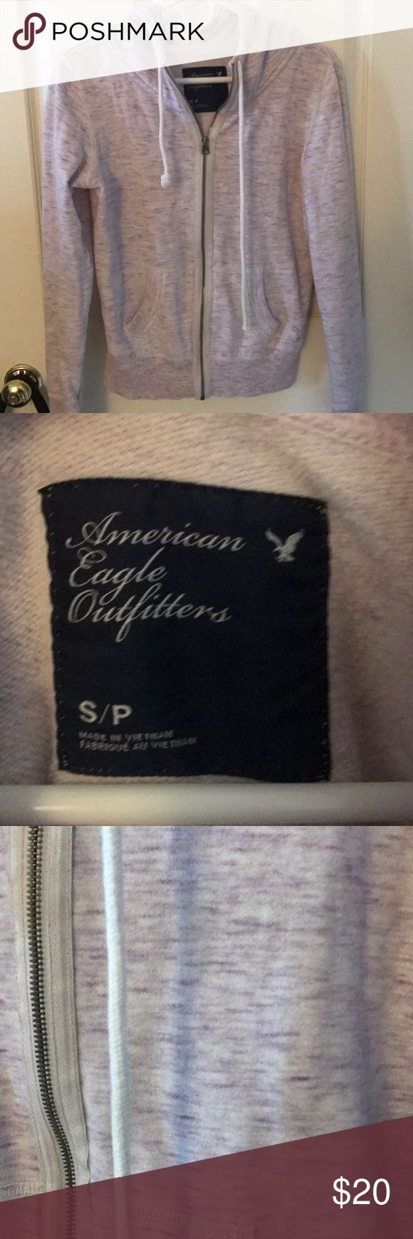 🦄American Eagle purple zip up hoodie size s/p Cute purple colored American Eagle zip up hoodie in size S/P. In fantastic condition. 60% cotton 40% polyester. Smoke free home. Bundle and save. Please check out my closet for more clothes, makeup and one of a kind Handcrafted jewelry. American Eagle Outfitters Tops Sweatshirts & Hoodies