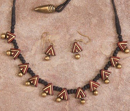 Handmade terracotta jewelry. Painted on Light brown. https://www.facebook.com/KavisTerracottajewellery