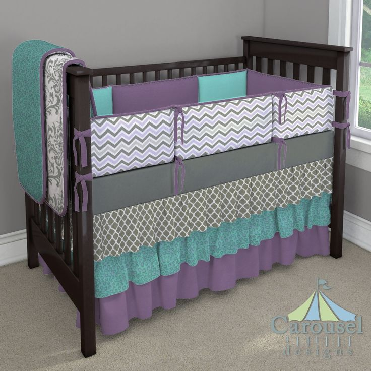 crib bedding in solid aubergine purple solid teal lilac and slate gray chevron