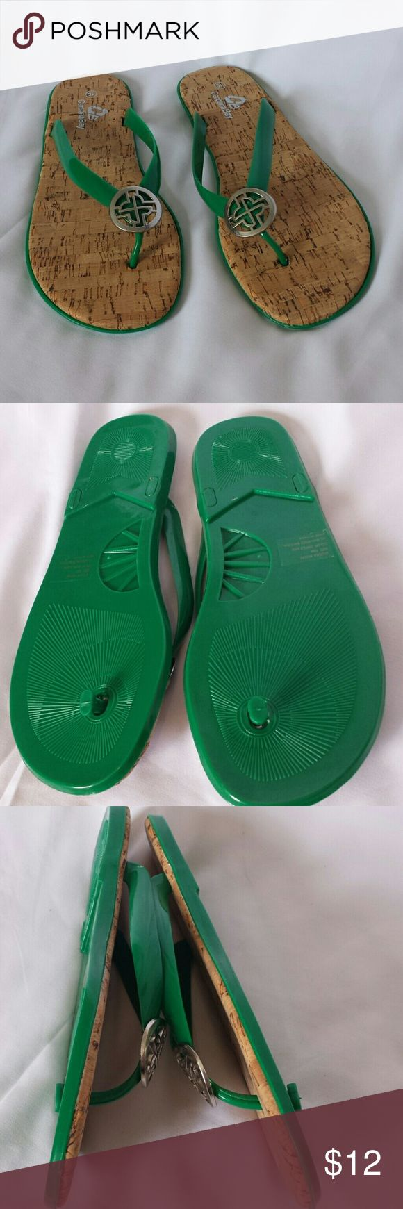 Green Flip Flops by Carolina Bay Size 10 Brand new! Never worn! Super sweet little green cork bottom flip flops with silver toe embellishment. Perfect for maxi's, a day at the beach, or casual with shorts! Shoes Sandals