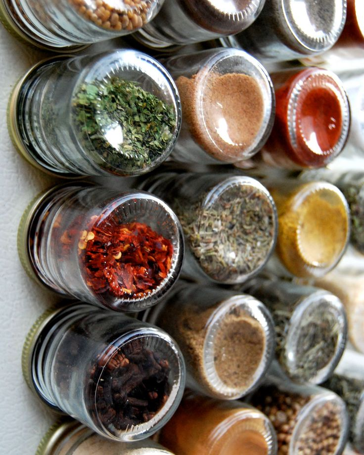 Magnetic Spice Rack jars. Make your own and use the side of the fridge?