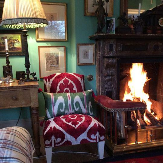 Room of the Day ~ vibrant print on slipper chair, startling green walls and cozy fire in home of Penny Morrison 3.31.2015