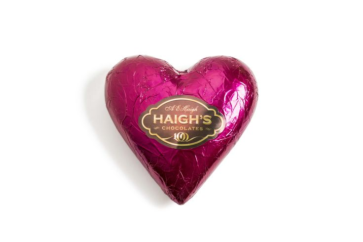 Large hollow milk chocolate heart in burgundy foil.