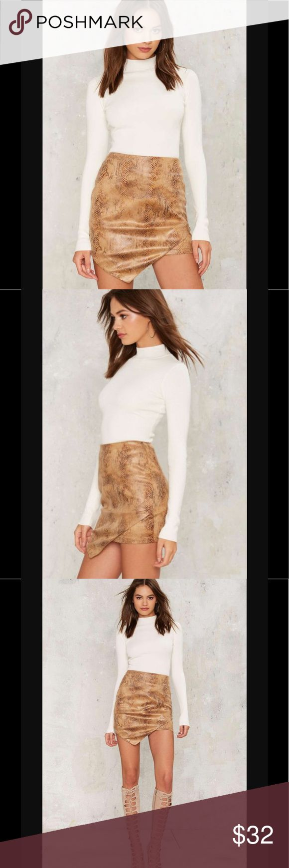 🆕💛Rack4 if all else scales asymmetric skirt Scale up. This mini skirt is made in super soft brown vegan suede, with a subtle snake print and asymmetric silhouette. By Rare London. *Layered detail at front  *Zipper at back  *Unlined *Content  100% Polyester  *Hand wash or Dry clean  *Imported California Residents: Nasty Gal Skirts Mini