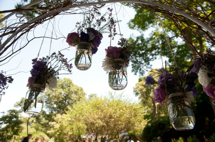 Hanging Mason Jars on the Trellis where the Ceremony was held  www.KingLilyFloralNY.com