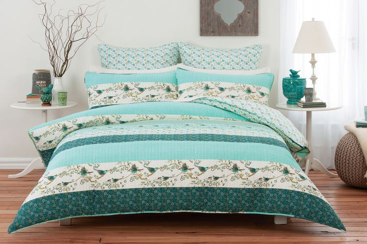 The playful mix of printed birds and plain and floral panels will brighten any bedroom #bedbathntable