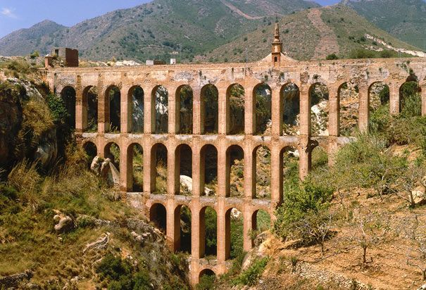 Aqueduct near Nerja, Spain: Used to transport water to population centers, most Roman aqueducts consisted of underground pipes.  Occasionally they crossed valley using a system of stone arches.